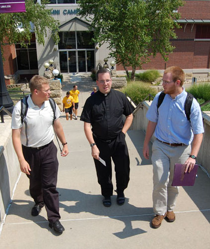 seminarians on campus with priest